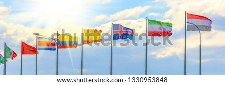 Russia, Samara, June 2018: National flags of the countries participating in the finals of the FIFA World Cup against a blue cloudy sky. #1330953848