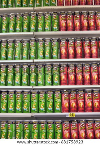 Russia, St. Petersburg 10,12,2014 Shelves with a variety of Pringles Chips #681758923