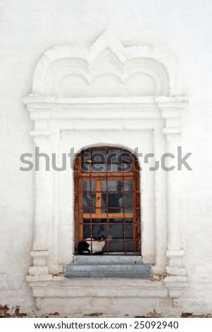 Russia. Suzdal. Cat sitting on the windowsill