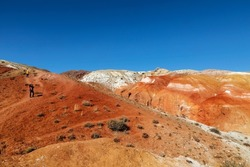 Russia, the Altai Republic. Red rocks in the Kyzyl-Chin tract,