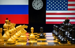 Russia vs USA, chess like geopolitics game. Flags of United States and Russian Federation behind chessboard. Concept of political tension, economy war, sanctions, leadership and relations strategy.