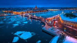 Russia. Winter in Russia. St. Petersburg. Night city. Ice floats along the Neva River. Evening Petersburg. Panorama of Petersburg. The bridge across the Neva. Panorama of Russia.