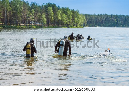 russian aqualungers going to dive into the woody lake #612650033