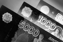 Russian banknotes 5000, 1000 and 500 rubles close-up. Dark black and white illustration about economy, money and finance of Russia. The picture looks like an engraving. Macro