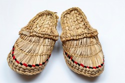 Russian bast shoes (Lapti) on white background. Traditional peasant Russian shoes made with bast fibers.