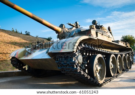 russian battle tank with blue cloudy sky in background