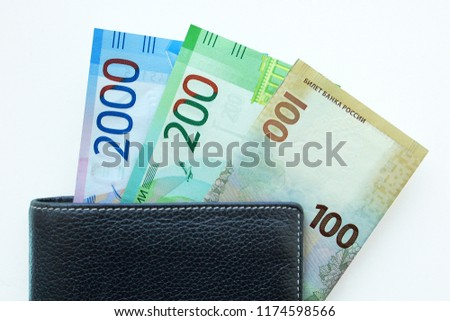 Russian cash. Bill in 2000 and 200 rubles. Black man's purse. Isolated on white #1174598566