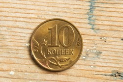 Russian coins in denomination of ten kopeks 2014 macro photo on a wooden background