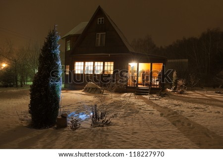 Russian county house (dacha) and decorated Christmas tree. Moscow region. Russia.