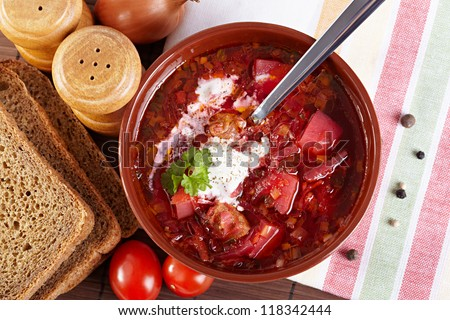 Russian cuisine. Borscht on the served table