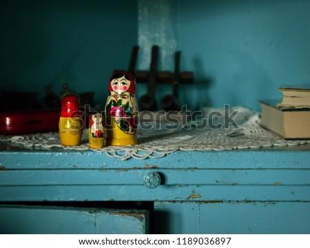 Russian Dolls on Cupboard #1189036897