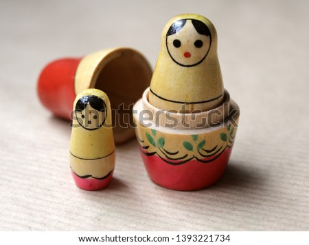 Russian dolls - wooden nesting dolls Matryoshka Babushka, vintage toys hand painted by unknown artisans with folk traditional feel. Little girl is lost and frightened and big dolls broken in pieces.