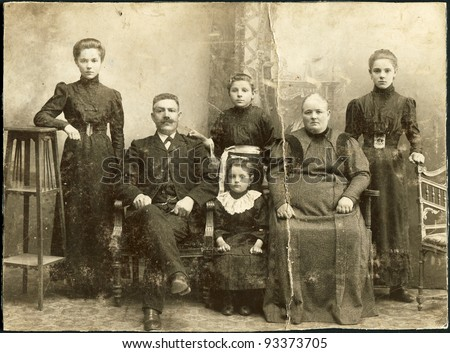 RUSSIAN EMPIRE - CIRCA 1907: A photo taking in the Russian Empire, shows a family of Russian Germans, man, woman and four children, Ust-Abakan sawmill, a veterinary station, circa 1907