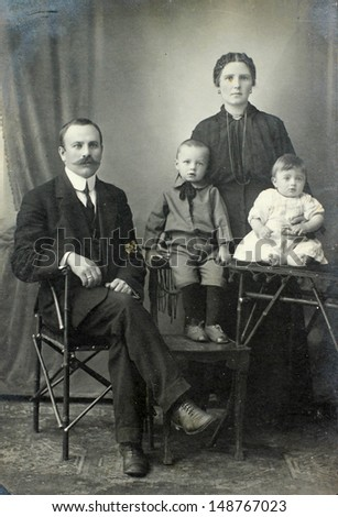 RUSSIAN EMPIRE - CIRCA 1900:Vintage family portrait. Mother, father and children. Nostalgic picture. Circa 1910. Russian Empire, beginning of 20th century.