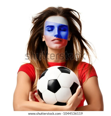 Russian fan sport woman player in red uniform hold soccer ball celebrating with windy hair isolated on white background