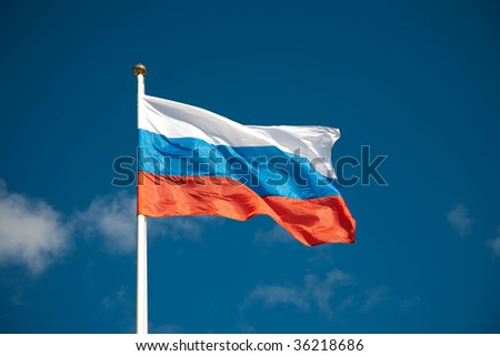 Russian flag against blue sky