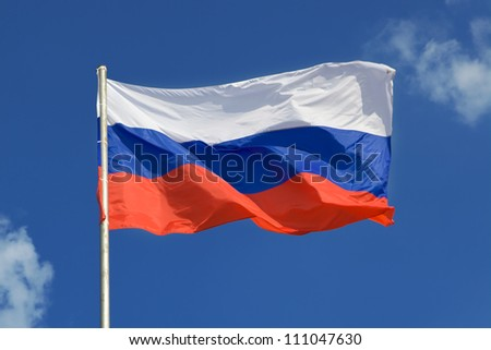 Russian flag, growing in the wind