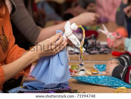 Shutterstock Russian folk crafts. Making rag doll Vesnyanka
