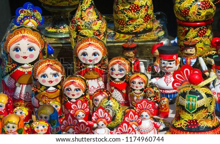 Russian folk  Khokhloma painting. this is the name of the hand-made style of Russian wooden painting and national ornament, famous for its curved and bright, mostly floral, berry and leaves