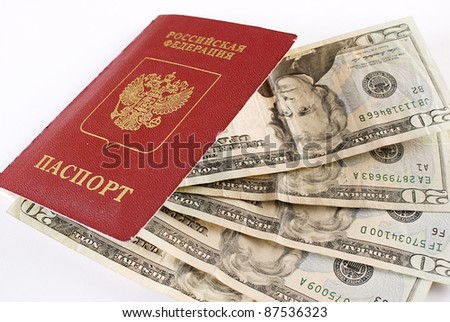 Russian international traveling passport and money over white background. Not isolated. - stock photo