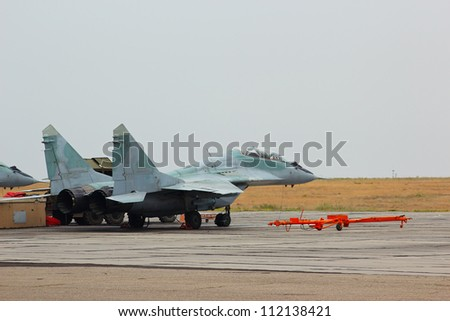 Russian jet fighter MiG-29 at an airfield - stock photo