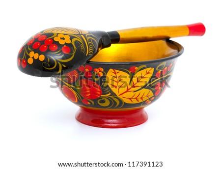 Russian Khokhloma bowl and spoon isolated on white