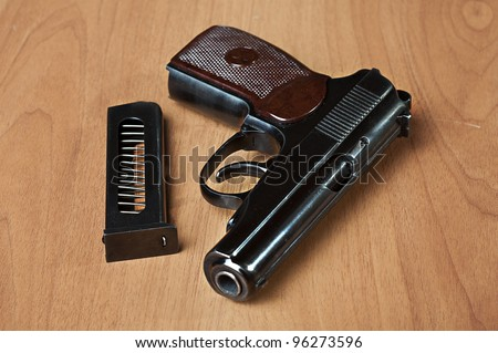 russian 9mm handgun PM (Makarov) on the table with holster, belt and empty pistol holder
