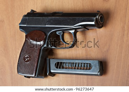Russian Hand Guns http://www.shutterstock.com/pic-96273647/stock-photo-russian-mm-handgun-pm-makarov-on-the-table-with-holster-belt-and-empty-pistol-holder.html