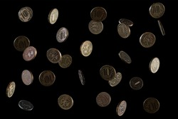 Russian money. Falling rubles, the face value of 10 rubles. Coins on a black background. Frozen fall. Space for text. Isolated on a black background.