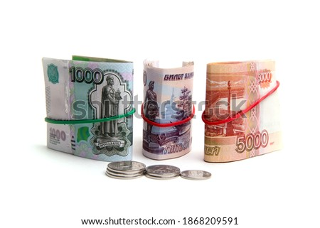 Russian money in denominations of five thousand, two hundred rubles, one thousand rubles, five hundred rubles.Five coins ,the ruble ,two rubles. Isolated on a white background .Background and texture