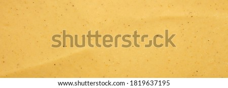 Russian mustard.The texture of the mustard.Yellow mustard background top view. Foto stock ©