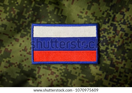 Russian national flag, military chevron on camouflage background #1070975609