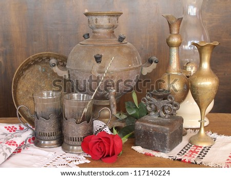russian old samovar, teapot, cup and beautiful and rose #117140224