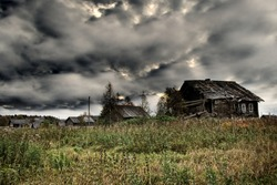 Russian old village on the edge of the forest is destroyed. North-West Russia, Wooden architecture of Karelians and Veps.