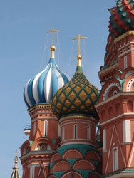 Russian onion domes from an Orthodox Church with a blue cloudy sky. Moscow. St. Basil.