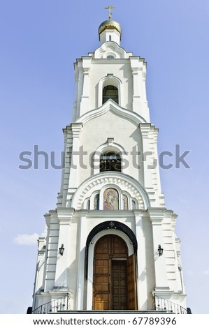 Russian orthodox church against the blue sky background. Front view