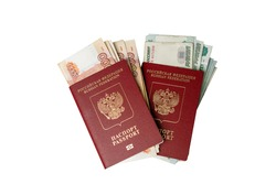 Russian passport with money for shopping abroad, travel and entertainment. Money is lying on the table light background.