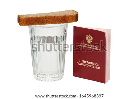 Russian pension certificate and glass of water with bread isolated on a white background. Translation text from Russian into English: pension fund of the Russian Federation. Pension certificate.