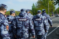 Russian police squad formation back view with. inscription - Rosgvardia