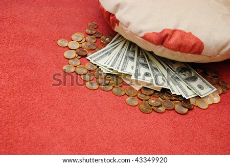 russian rubles and american dollars are stored under pillow