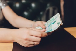 Russian rubles in the hand of a fan.male hand holding many of the Russian banknotes.The transfer of money.The isolated five-thousandth of Russian rubles denominations in a hand.