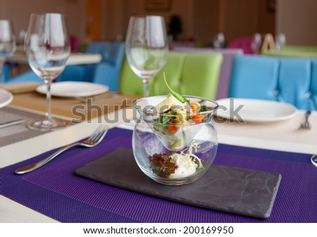 Russian salad in creative serving on restaurant table