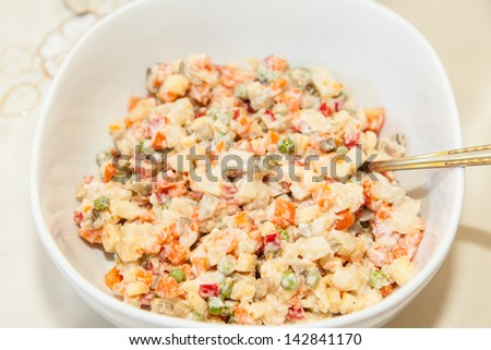 Russian salad or Salade russe, also known as Salade Olivier is a salad composed of diced potato, vegetables and sometimes meats bound in mayonnaise.