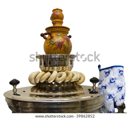Russian samovar and steering-wheels on a white background