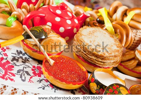 Russian Shrovetide meal - pancake with caviar and tea
