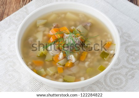 Russian soup rassolnik with chicken gizzards and barley, closeup