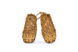 Russian traditional ancient bast shoes made of bast isolated on white background