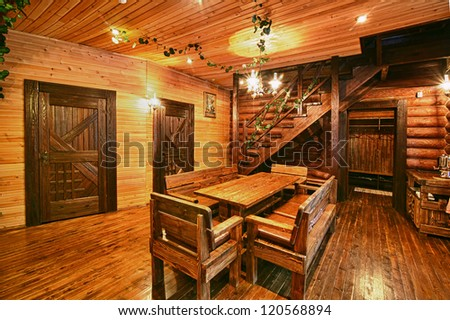 Russian traditional wooden interior with table and fixtures