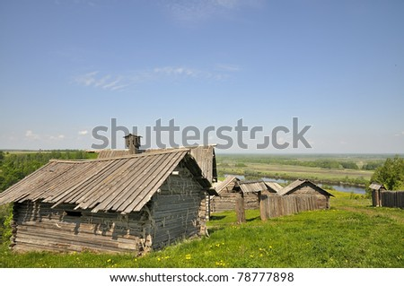 Russian village. The old traditional village on the riverbank. The village is on a high hill.