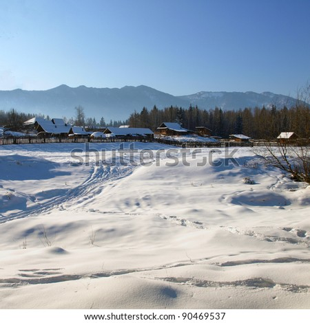 Russian village Zamulta in winter in Uimon Valley, Altai mountains.